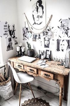 Turn a neglected corner into an office epicenter by simply taping up an assortment of powerful portraits and quotes above your otherwise unpolished desk area. If you're lucky enough to land a raw writing desk, even better, but if not, just sit back and let all of the stunning snapshots make a statement. #refinery29 http://www.refinery29.com/desk-inspiration#slide-3