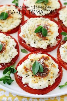 Italian Three-Cheese Baked Tomatoes _ Fresh sliced tomatoes topped with a trio of cheeses & baked until irresistibly hot & gooey. The acidic bite of the tomato is balanced by the mildness of ricotta, mozzarella & Parmesan cheese(s), the Italian-American trinity of cheese. Sprinkle with Parmesan cheese & top with fresh basil or oregano to serve!