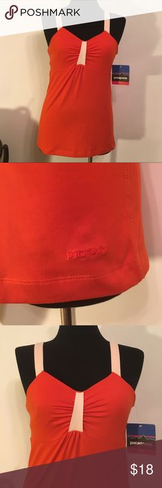 Patagonia New Large Workout Tank Bra Woman's L New with tags  Woman's  Orange w/ pink highlights  Patagonia  Workout Tank  Large  Built in sports bra  Underarm to underarm measures 16/17  Length measures 19/20 Smoke free / Pet free home Patagonia Tops Tank Tops