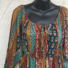 NEW ITEM! Bohemian Sheer Dress This dress is gorgeous! Can be worn as a dress or a tunic. Has long sleeves, scoop neck, flounce ruffle hem, and elasticize a waist. Beautiful fall colors but can definitely be worn year round. It is sheer, so a tank is needed. Dresses