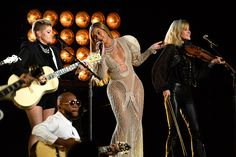 What did you think of the CMA Awards last night? Our resident country music fans review the star-studded ceremony and share their favorite highlights of the evening. #CMAawards50 #countrymusic #music #entertainment #news #popculture #beyonce #dixiechicks #carrieunderwood #bradpaisley #timmcgraw #garthbrooks