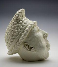 Narrative handmade ceramic figurative sculpture with three eggs