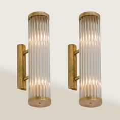 PAIR OF VENINI WALL LIGHTS Italian, 1950s, cylindrical brass wall lights on arms, signed 'Venini.'