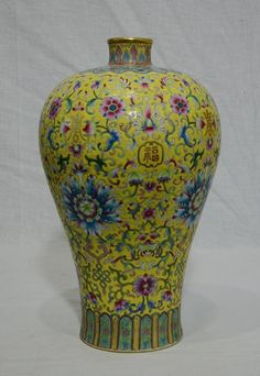 Chinese Famille Rose Porcelain Vase / Six red character mark on the base / Estimate $800-$1,200
