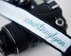 A beautiful personalized gift for you or your favorite photographer. Choose to personalize it embroidered with a first name, I'm about to snap, I shoot people for a living or Don't be negative. Price includes seersucker camera strap embroidered in a coordinating thread color with your choice of personalization.