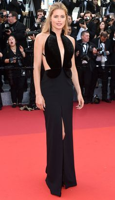 DOUTZEN KROES  in a Brandon Maxwell gown with a plunging velvet bodice and front slit at the opening ceremony and Café Society premiere.
