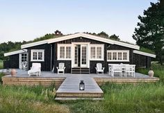 Sweet Swedish Stuga (yes, with grass on the roof!)... my green dream home! Love the big porch, too!