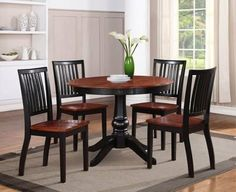 """Dinette Set (5 Piece) in Black Finish by Homelegance by Homelegance. $503.72. Koto Veneer. Black Finish. 5 Piece Set. The Dinette Set (5 Piece) in Black Finish by Homelegance is so literally named because they are made for one purpose, and one purpose only: total and complete functionality. Well, functionality and the ability to instantly stylize any decor. Dimensions:Table: 42"""" Dia. X 30""""HChair: 18"""" X 21.25"""" X 36""""H Some assembly may be required. Please see product details."""