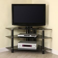 @Overstock - This space-saving glass corner TV stand offers two levels for storing your electronics and a top shelf that can easily handle televisions up to 48 inches. The safety glass construction puts a modern twist on a traditional piece. http://www.overstock.com/Home-Garden/44.-Corner-Black-Glass-TV-Stand/3457038/product.html?CID=214117 $142.99
