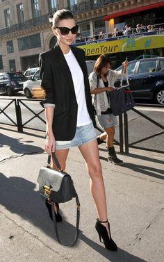 Black blazer. White t-shirt. Jean skirt. Boots. Sunglasses.