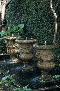 If there's one place where repetition work's it's in a water feature. While one of these classic urns would look attractive in this romantic garden at Morells Boutique Avenue, three makes a real statement. Outdoor Water Features, Water Features In The Garden, Garden Features, Garden Urns, Garden Fountains, Water Fountains, Outdoor Fountains, Landscape Design, Garden Design