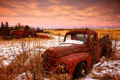 Alberta, Canada.  I wonder if the gunshot through the windshield has anything to do with this truck being abandoned. Breathtaking photo!