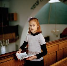 Portrait of Orthodox Girl in Synagogue Wins International Photography Award 'Chayla in Shul' will be displayed in London's National Portrait Gallery