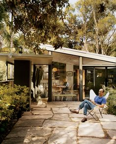 """Los Angeles home of architect and activist Cory Buckner. The house she shares with her husband, Nick Roberts, was designed by A. Quincy Jones. Roberts, an architecture professor at Woodbury University, comments, """"The building section is a metaphor for America's boundless self-confidence after World War II: The building literally takes flight across the canyon."""""""