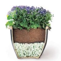 use styrofoam peanuts when planting in a large planter. Not so heavy and saves on soil.