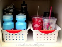 If your water bottles and drinking cups have ever toppled out of the cabinet, check out this great idea for cabinet organization. Dollar Tree carries water bottles, drinking cups, and storage baskets for only $1 each.