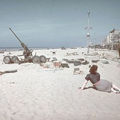 LIFE 76 years ago today, on May 26, 1940, The WWII Battle of Dunkirk began. This photo depicts a woman on a beach strewn with abandoned supplies and a derelict artillery piece near Dunkirk after the Allied retreat taken by one of Hitler's personal photographers, Hugo Jaeger. (Hugo Jaeger—The LIFE Picture Collection/Getty Images) #tbt #france #wwii
