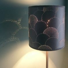 I love this pin-pricked lampshade, with certain holes augmented by GEMS! PRECIOUS GEMS! …Or more likely, some dime-store plastic sparklies.