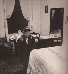 """Andrew Ratoucheff    Actor, 56, in his Manhattan rooming house following a late show performance of his specialty imitations of Marilyn Monroe and Maurice Chevalier singing """"Valentina.""""  THE VERTICAL JOURNEY  Diane Arbus  Esquire July 1960"""