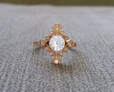 Bands sold separately    This Spectacular PenelliBelle Exclusive Design Features a 14K Rose Gold Etched Antique Art Nouveau Style Setting. Set with