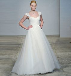 Love it-- without the flowers on the straps and with a wide satin sash around the middle...