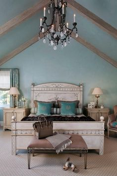 Charming, cool soft teal coloured walls and ceiling frame a French inspired bed and nightstands