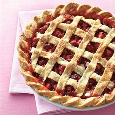 Classic summer flavors. This strawberry rhubarb pie is flavored with grated orange zest.