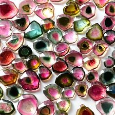 Cross-sectional Slices of Watermelon Tourmaline and other Bi-colour and Tri-colour Tourmalines. Rainbow sweeties! #pixiecrystals -x-