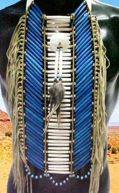 Native American Style Breastplates From Tribal And Western Impressions. This is made of pony beads, side leather fringe, glass beads and feathers. The breastplate is done with died blue and white hairpipe bone beads Native American Regalia, Native American Clothing, Native American Beauty, Native American Crafts, Native American Beadwork, American Indian Art, American Indians, Native Indian, Native Art