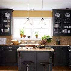 A Black and Gold Kitchen Gold-flecked granite countertops with black cabinets that look more like dark gray; glass-front cabinets & a large double window Dark Kitchen Cabinets, Kitchen Redo, New Kitchen, Kitchen Ideas, Space Kitchen, Kitchen Designs, Open Cabinets, Gray Cabinets, Cheap Kitchen