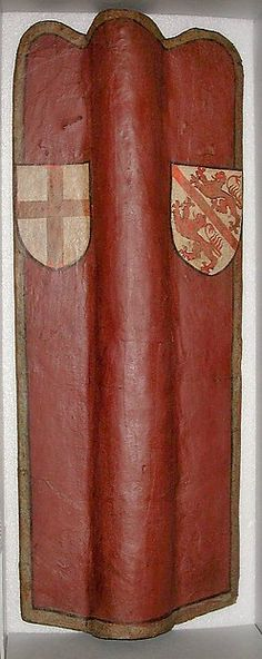 Archer's Shield (Pavise) Date: 15th century Geography: Swiss Culture: German Medium: Wood, linen, pigskin, gesso, pigment Dimensions: H. 41 1/8 in. (104.4 cm); W. 15 7/8 in. (40.3 cm); Wt. 11 lb. 3 oz. (5074.56 g) Classification: Shields Credit Line: Gift of William H. Riggs, 1913 Accession Number: 14.25.776