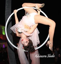 Kikimora Studio Lollipop Lyra aerial show in vintage French Victorian Rococo theme. Majestic Colonial costume with aerialist or contortionist. Ambient, interactive, or champagne service.