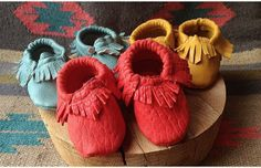 all the colors of a rainbow moccs available in sizes 0-6 months up to 9 toddler