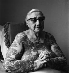 Bobbie Libarry, 1976, photographed by Imogen Cunningham. Libarry was an attraction turned tattooist in San Francisco. The ninety-three-year-old Cunningham, who photographed the eighty-three-year-old Libarry in a hospital, thought this was one of her best portraits. It was also one of her last, taken just months before she died.