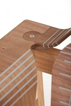 Flat pack plywood scored and gaps filled with flexible polymer to create bends.