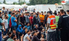 Asylum-seekers line up at an admission center in Dresden.