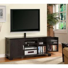 This TV stand is a simple yet elegant design. This TV stand features an integrat ed flat panel mounting area for a perfect all-in-one entertainment center solution.