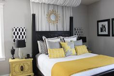 Yes! black headboard, black & white photos, yellow and grey.