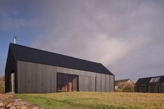 """Mary Arnold-Forster Architects designed the tin-clad Black Shed house on the Isle of Skye for an architect and a rabbi with an """"interest in melancholy. Black Shed, Black House, Farm Shed, Open Architecture, British Architecture, Agricultural Buildings, House Ideas, Wood Cladding, Shed Homes"""