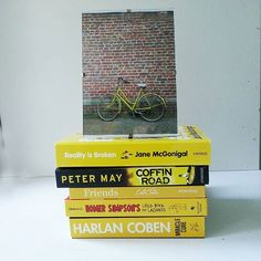 Some novels, one educational and some just fun. A photo of my bike during erasmus and my yellow books for #bookishpride