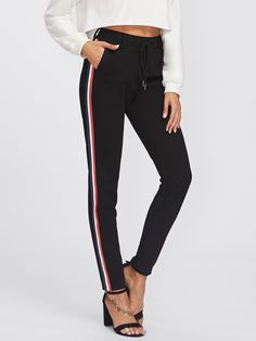 Long Drawstring Waist, Elastic Waist. Tapered/Carrot Decorated with Drawstring. Regular fit. High Waist. Striped design. Trend of Spring-2018, Fall-2018. Designed in Black. Fabric has no stretch.
