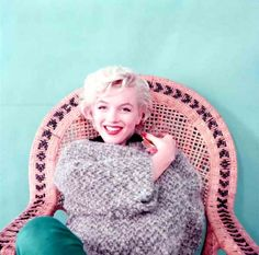 * m. Marilyn. Wickerchair sitting. Photo by Milton Greene, 1954.