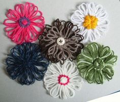 Yarn flowers - Hi, I'm glad you like them – I can't take any credit for the actual tutorial though – the ideas all came from http://knitting-and.com/small-looms/ and I just picked the methods I liked best, took photos as I went along and linked to the actual tutorials – head on over there for many more small looms and more in depth instructions.