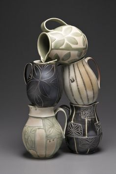 "Brad Johnson  |  Little jugs.  ""Full and graceful pots have become blank canvases for johnson to decorate, by literally drawing on their surfaces with a sharp tool, leaving an incised line. This series of pieces are salt fired, combining a black slip with his white porcelain body""."