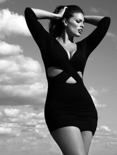 Plus model Ashley Graham in body-con cutout mini dress w/deep V-neckline
