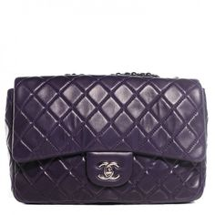 This is an authentic CHANEL Lambskin Quilted Jumbo Single Flap in Dark Purple. This classic Chanel shoulder bag is crafted of soft and smooth diamond-quilted lambskin leather.