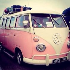 A Pink VW bus ready to explore the open road.