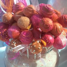 cake baller cake pops in pink and orange for a fun wedding dessert table. www.cakeballers.com #cakeballers #thecakeballers #cakeballer #cakepops #letthemeatcakeballs #weddingdaypops