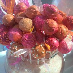 cake baller cake pops in pink and orange for a fun wedding dessert table. www.cakeballers.com #cakeballers #thecakeballers #cakeballer #cakepops #letthemeatcakeballs #weddingdaypops