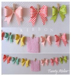 Paper bow garland.  this is so sweet :) great for a girl baby shower!